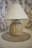 Straw table and lamp shades to decorate rooms. Straw table and lamp shades to decorate rooms stock photo