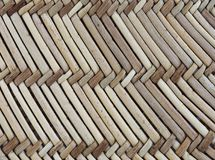 Straw texture in a diagonal pattern. A closeup of straw in various colours in a repeating diagonal pattern stock photography