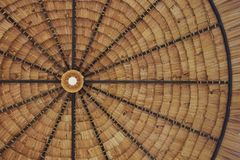 Straw thatched roof background with light bulb royalty free stock images