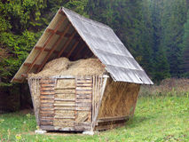 Straw in timber barn stock image