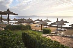 Straw umbrella on the beach Royalty Free Stock Photo