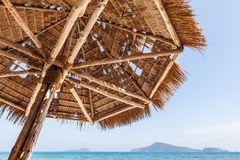 Straw umbrella on beach Stock Photography