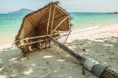 Straw umbrella on beach Stock Image