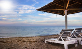 Straw umbrella chair beach relaxation Royalty Free Stock Photography
