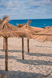 Straw umbrella on the hotel beach Royalty Free Stock Photos
