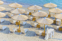 Straw umbrella making a pattern on the beach. Top view of beach straw umbrella making a nice pattern on crystal clear water ocean coast Stock Photo