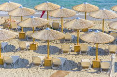 Straw umbrella making a pattern. Top view of beach straw umbrella making a nice pattern on crystal clear water ocean coast Stock Photography