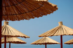 Straw umbrellas on a beach Royalty Free Stock Image
