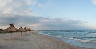Straw umbrellas on beach Stock Photography