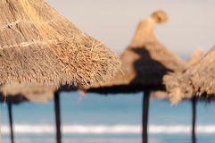 Straw umbrellas Royalty Free Stock Images
