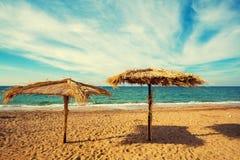 Straw umbrellas on a beach Stock Photography