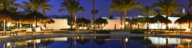 Straw umbrellas and sunbeds by the pool in Sharm El Sheikh Stock Image