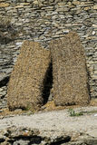 Straw in a wall of stones Royalty Free Stock Photography