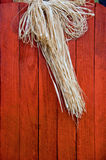 Straw on wooden door Stock Images