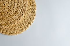 Straw woven circle on a gray background. stock photo