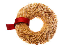 Straw wreath with red robbon Stock Images