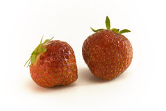 Strawbeery Fruits. Two Strawbeery Fruits lying on white background stock images