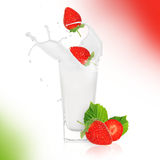 Strawberies with milk splash. Over white Stock Photos