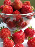 Strawberries. Fresh Strawberries in glass plate and on white surface Royalty Free Stock Photo