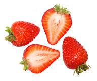 Strawberries. Two whole and two half strawberries Stock Photos