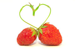 Strawberries. The composition of two strawberries with  stalk in form of heart Royalty Free Stock Images