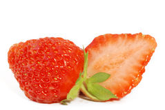 Strawberries. Cut in half strawberry on  white background Royalty Free Stock Photos