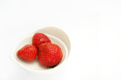 Strawberries. Juicy strawberries in porcelaine bowl isolated on white background Stock Image