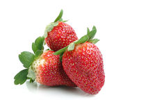 Strawberries. Three fresh strawberries cut in white background Royalty Free Stock Photo