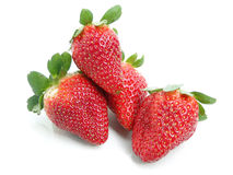 Strawberries. Four fresh strawberries cut in white background Royalty Free Stock Photo