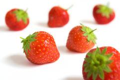 Strawberries. A lot of strawberries on a white surface Royalty Free Stock Images