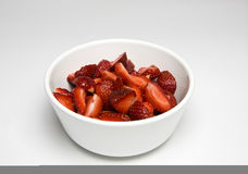 Strawberries. Some sliced strawberries in white bowl; isolated on white Royalty Free Stock Image