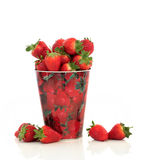 Strawberries. In a metal container with strawberry design, over white  background Royalty Free Stock Photo