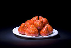 Strawberries. On a white saucer Royalty Free Stock Images