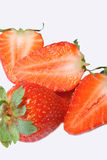 Strawberries. This is a composition of a strawberry and a cut strawberry stock photo