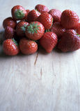 Strawberries. Red and fresh strawberries on a wooden table Royalty Free Stock Images
