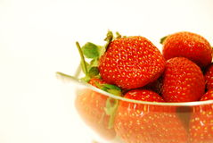 Strawberries. In a bowl on a white  background Stock Photo