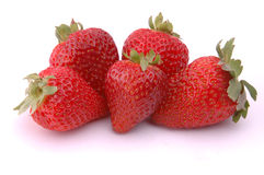 Strawberries. Five juicy strawberries on white Stock Image