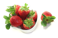 Strawberries. In a bowl on a white background royalty free stock photo