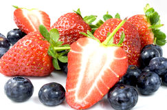 Strawberries. White plate with blueberries and strawberries Stock Images