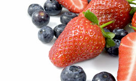 Strawberries. White plate with blueberries and strawberries Royalty Free Stock Photography