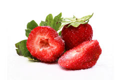 Strawberries. On sugar isolated over a white background royalty free stock photos