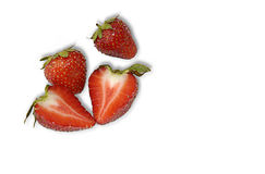 Strawberries. This is a composition of a strawberry and a cut strawberry royalty free stock photography