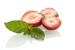 Strawberries. Wiht mint leaves on white background Stock Images