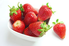 Strawberries. Fresh strawberries in a white bowl on a white background Stock Images