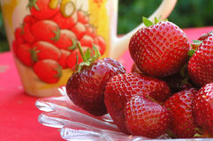 Strawberries. On plate and with a strawberry mug too royalty free stock photo