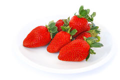 Strawberries. In plate isolated on white background Royalty Free Stock Photo