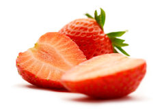 Strawberries. Is sliced in half on white background Stock Photo
