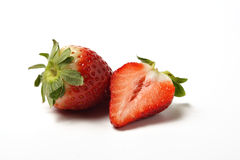 Strawberries 2. A whole and a half strawberry, white background stock image