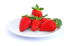 Strawberries. In plate isolated on white background Stock Photos