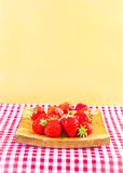 Strawberries. Fresh ripe strawberries on gingham Stock Photo